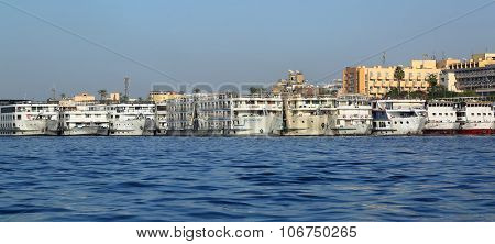 old passenger ships standing in Luxor port on Nile river