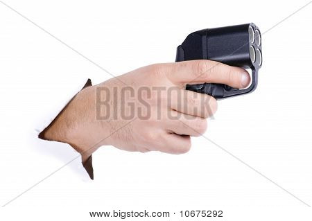 Hand With Traumatic Gun On White