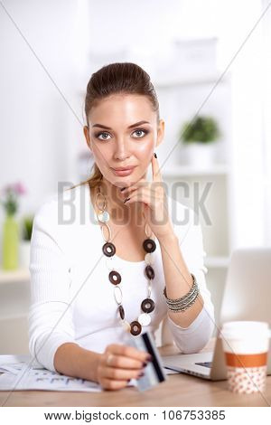 Businesswoman doing online shopping through laptop and credit card