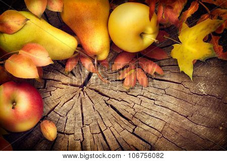 Thanksgiving frame background. Autumn Fall background with colorful leaves, apples and pears, Beautiful vintage styled autumn fruits and colorful leaves over wooden table
