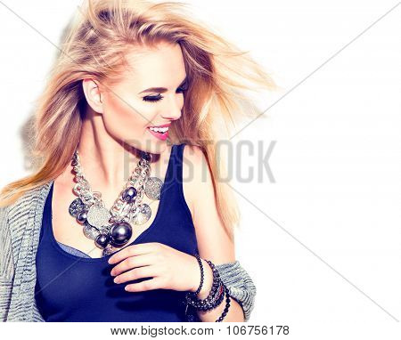 Fashion model girl portrait casual dressed, modern accessories - necklace and bracelets. Beauty young smiling woman, Blowing blond hair, fashion make up. Street fashion, urban style. Isolated on white