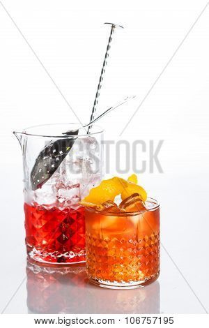 Amber cocktail in a glass isolated on white background