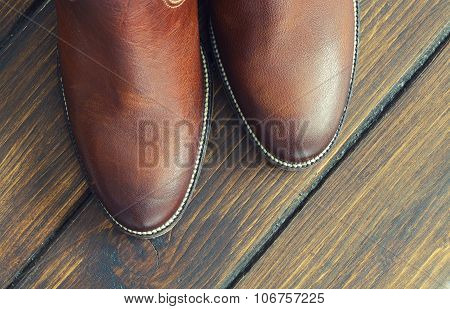 Brown  Shoes On A Wooden Background