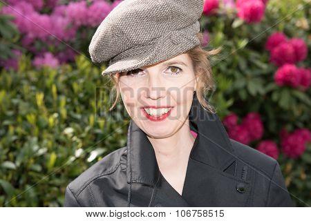 Attractive Woman In The Garden