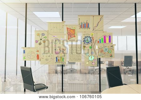 Business Scheme Concept Posters On Vitreous Wall In Light Office