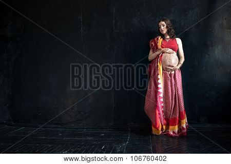 The pregnant woman with henna tattoo