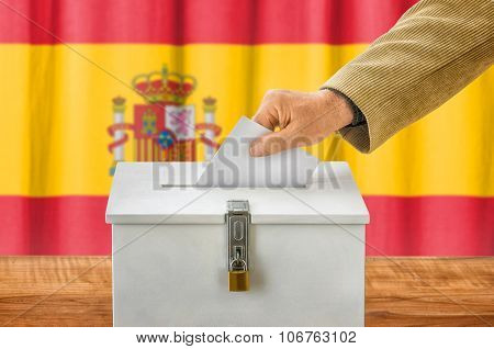 Man Putting A Ballot Into A Voting Box - Spain