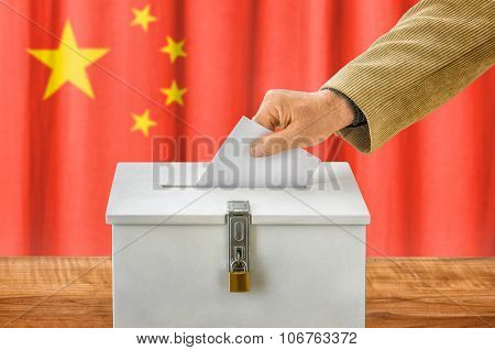 Man Putting A Ballot Into A Voting Box - China