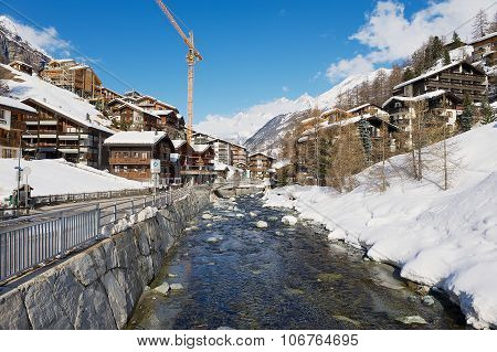 View to the river and traditional houses in Zermatt, Switzrland.