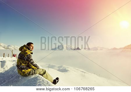 Man at mountains in clouds, Val-d'Isere, Alps, France