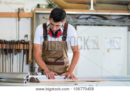 Carpenter or cabinet maker in his wood workshop