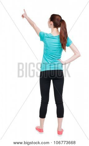 Back view of  pointing woman in sportswear. beautiful girl. Rear view people collection.  backside view of person.  Isolated over white background. Athlete showing his hand up