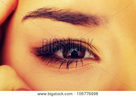 Beautiful woman eye with long eyelashes.