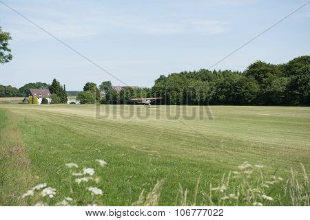 Small Aircraft Just Landing On Grass