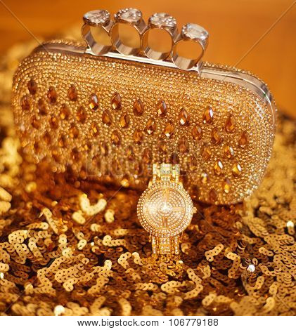 Fashion Golden Womens Accessories. Luxury Wristwatch And Purse, On Yellow Sequins Sparkling Sequined