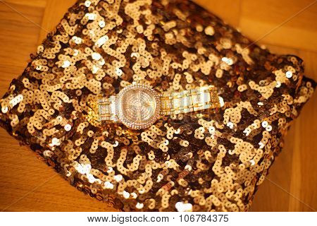 Fashion Womens Wristwatch On Golden Sequins Sparkling Sequined Textile.