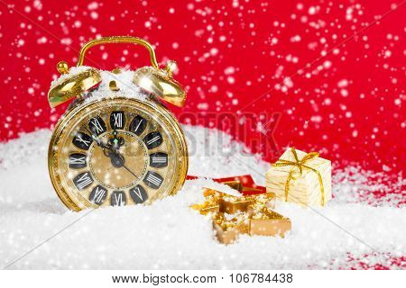 Vintage Christmas Decoration Golden Star And Antique Golden Clock In Snow On Red Background