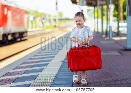Cute Little Girl On A Railway Station.