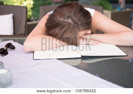 Attractive Young Girl Is Sleeping On Workbook