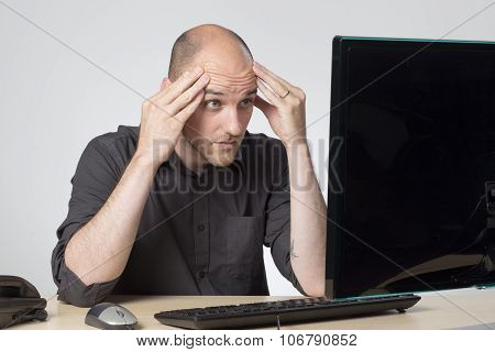 Looking At Screen In Disbelief
