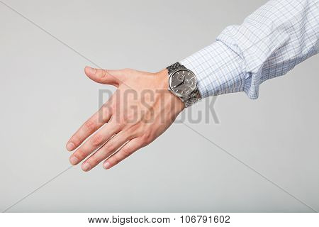 oung businessman extends his hand for a handshake.
