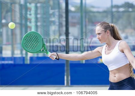 Girl Playing Paddle Tennis Outdoors.