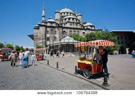 Fast Food Stall And Tourists Walking Past The 17Th Century Mosque In Istanbul