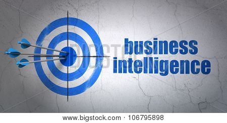 Finance concept: target and Business Intelligence on wall background