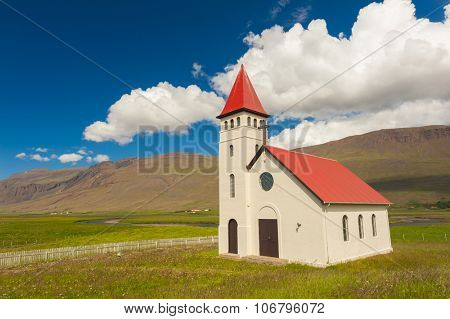 Beautiful small Icelandic church in the rural area under the mighty fjords