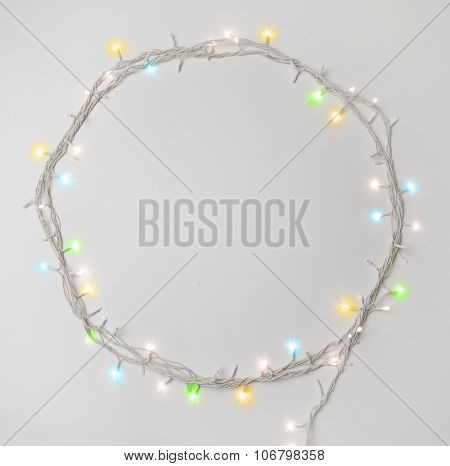 Series of tiny christmas lights. Round shape border made with decorative lights.