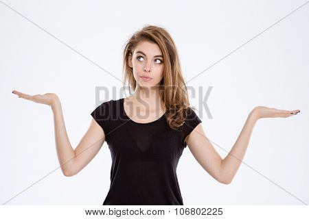 Portrait of a thoughtful woman holding copyspace on the palms isolated on a white background