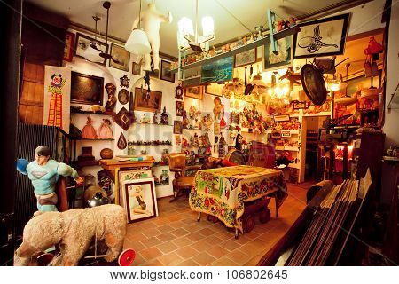 Antique Shop With Second Hand Furniture, Toys, Books And Art-objects