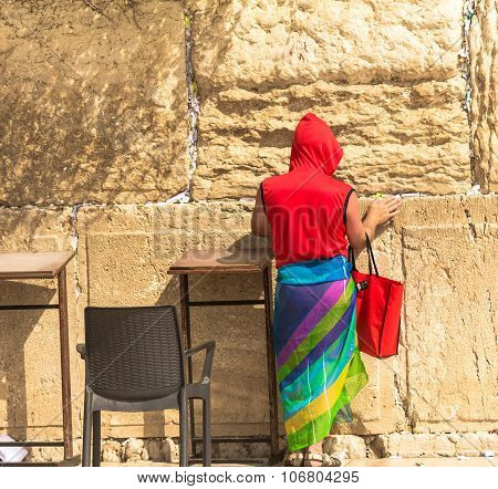 Unidentified Tourist In A Bright Red Jacket And Colorful Female Scarf At Western Wall
