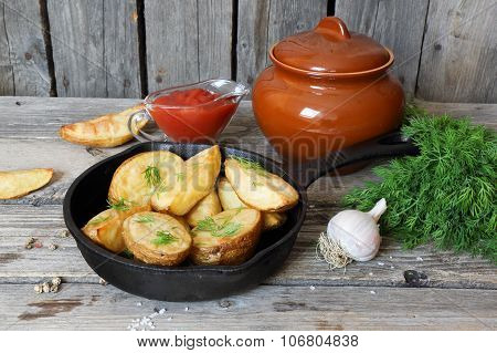 Baked Potatoes With Dill In Village In A Cast Iron Frying Pan