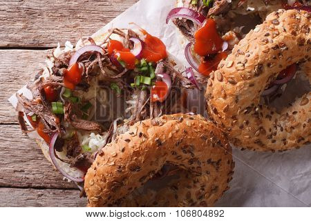 Bagels With Pulled Pork And Sauce Close-up Horizontal Top View