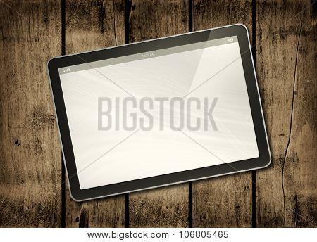 Digital Tablet Pc On A Dark Wood Table