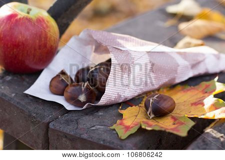 roasted chestnuts on wooden bench