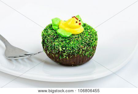 Chocolate cake decorated with duck on white dish