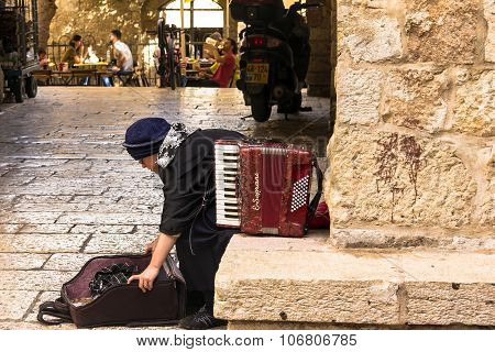 Woman Musician Accordion In One Of The Corners Of The Jewish Quarter Of The Old City. Jerusalem, Isr
