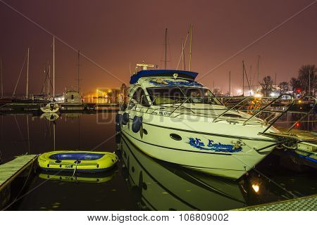Motor Boat And Pontoon Moored To The Jetty
