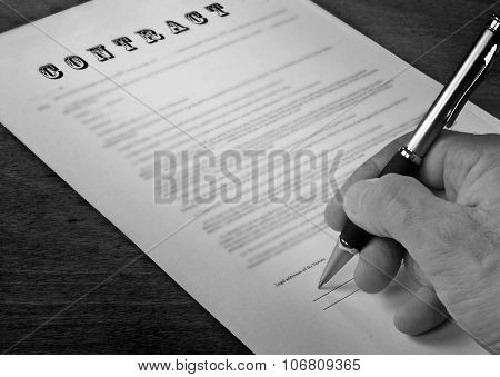 Conceptual Photograph Of Contract Signing