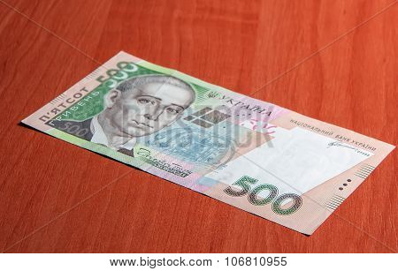 Ukrainian Money Hryvna On Wooden Background