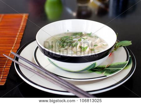 Traditional Vietnamese beef soup pho . Wooden background