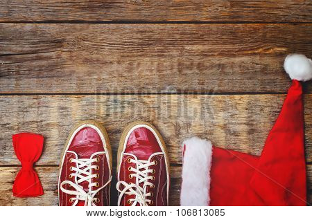 Wood Background With Sneakers Red Hood And A Bow