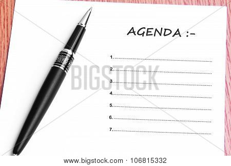 Pen  And Notes Paper With Agenda List