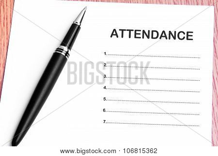 Pen  And Notes Paper With Attendance List