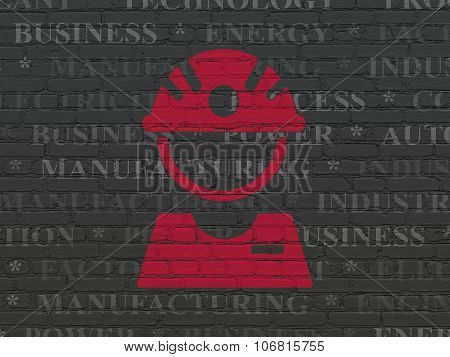 Industry concept: Factory Worker on wall background