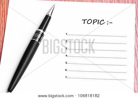 Pen  And Notes Paper With Topic List