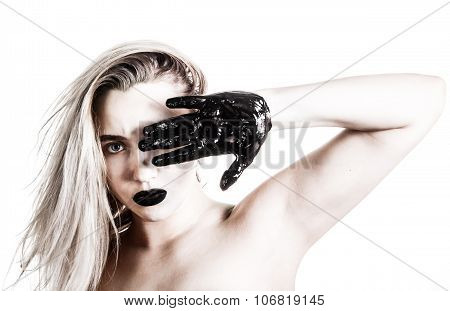 Woman Covering Herself With A Tarred Palm