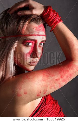 Young Woman Covered With Red Paints